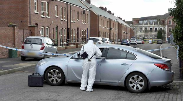 Police at forensic officer at the scene of the Mill Street, Lisburn pipe bomb attack. Pic: Stephen Hamilton