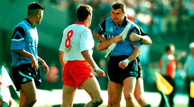 Flashback: Charlie Redmond is held backfrom Feargal Logan back in 1995