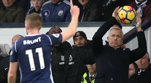 Angry words: Chris Brunt (left) criticised his West Brom boss Alan Pardew (right)
