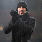 Big hand: Pep Guardiola hails the travelling City supporters