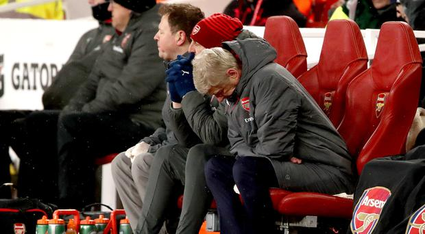 Arsene Wenger shows his dejection against Manchester City