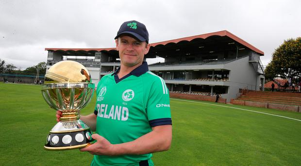 Top prize: Ireland captain Wiliam Porterfield gets his hands on the World Cup qualifying trophy