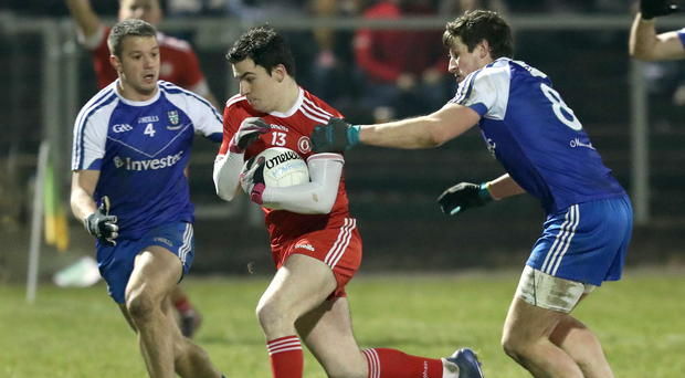 Old foes: Monaghan's Ryan Wylie and Darren Hughes take on Lee Brennan of Tyrone