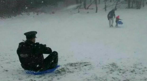 Officers get involved in the snow action in Lurgan / Credit: PSNI
