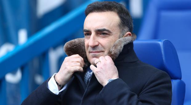 Swansea manager Carlos Carvalhal praised his side's spirit after their 4-1 victory over West Ham
