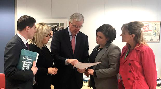 (left to right) MEP Matt Carthy, Michelle OÕNeill, EU chief negotiator Michel Barnier, Mary Lou McDonald and MEP Martina Anderson, during a meeting in Brussels on Monday. Credit: Sinn Fein/PA Wire
