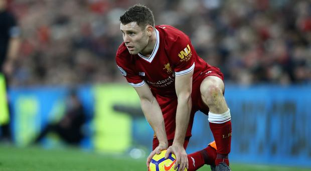 On the ball: Reds ace James Milner leads the assisting charts
