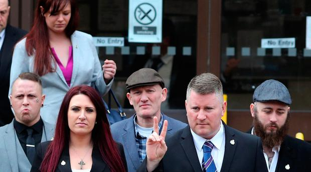 Paul Golding (third right) and Jayda Fransen (centre), leader and deputy leader of far-right group Britain First and supporters upon arrivial at Folkestone Magistrates' Court / Credit: Gareth Fuller/PA Wire