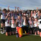 Rainey Endowed captain Erin Mulholland celebrates with team-mates after winning the Belfast Telegraph Schools' Cup.