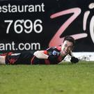 Winging it: Paul Heatley celebrates one of the many goals that Crusaders chalked up at Mourneview Park