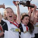 Glory girls: Rainey Endowed hoist the Belfast Telegraph Schools' Cup aloft after heroics from goalkeeper Erin Mulholland