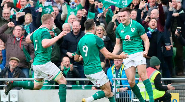 Ireland's wing Jacob Stockdale (R) celebrates after scoring his team's second try in the win over Scotland.