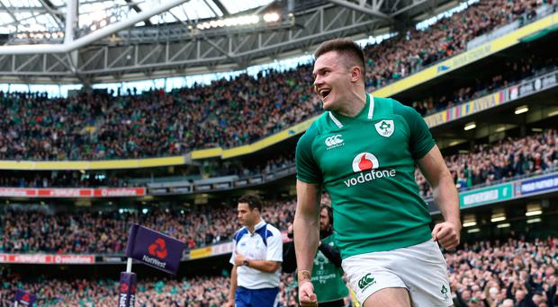 Ireland's Jacob Stockdale celebrates scoring a try during the NatWest Six Nations match at the Aviva Stadium, Dublin.