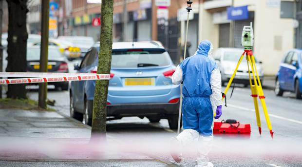 Police and forensics at the scene of a 1 vehicle RTC on the Springfield Road in west Belfast on March 11th 2018 (Photo by Kevin Scott / Belfast Telegraph)