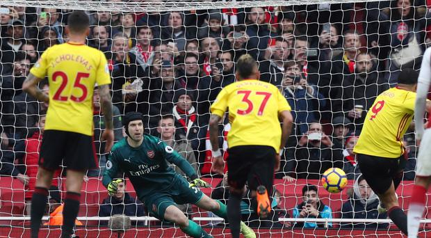 Petr Cech saves a penalty from Watford's Troy Deeney