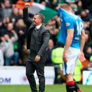 Happy man: Brendan Rodgers savours derby success at Ibrox