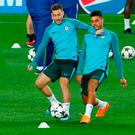 Preparation: Eden Hazard and Emerson Palmieri train at the Nou Camp last night