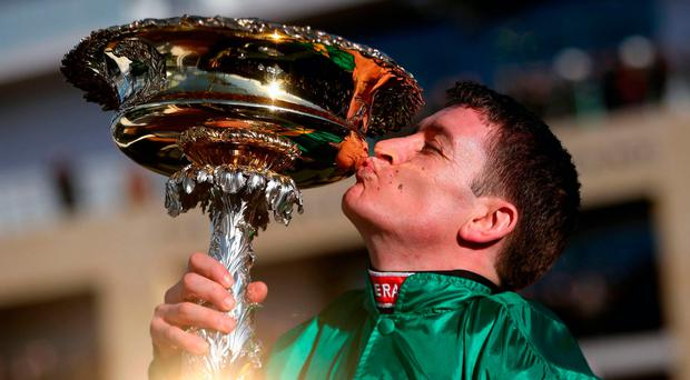 Too sweet: Barry Geraghty kisses the Champion Hurdle trophy