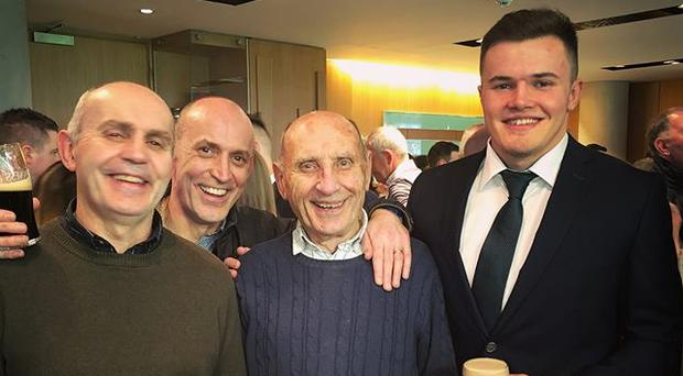 All smiles: Jacob Stockdale with family including his father Graham and grandfather Ivan after the win over Scotland.
