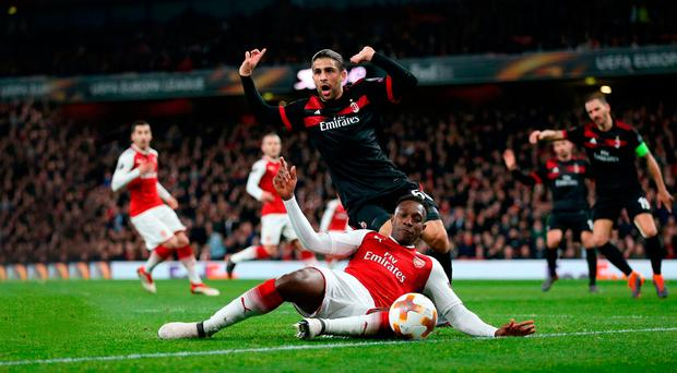 Shock: Ricardo Rodriguez protests his innocence as Danny Welbeck tumbles