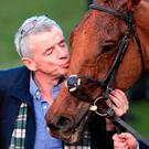 Flying high: Michael O'Leary kisses winner Balko Des Flos