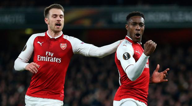 Arsenal's Danny Welbeck (right) celebrates scoring his side's first goal of their last 16 tie second leg against AC Milan.