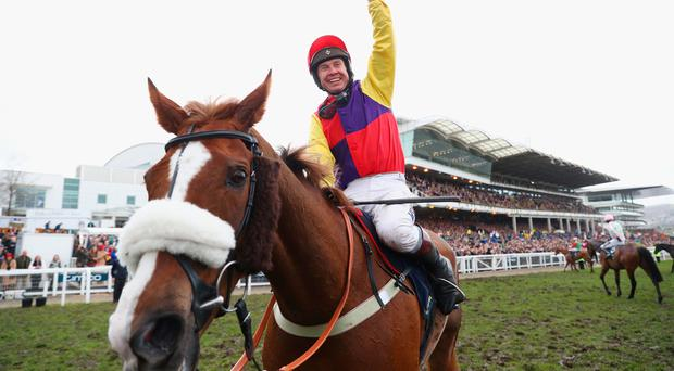 Richard Johnson on Native River celebrates after winning the Timico Cheltenham Gold Cup Chase.