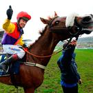 Thumbs up: Richard Johnson on Native River celebrates Gold Cup glory