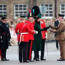 The Duchess of Cambridge presents shamrock to officers and guardsmen of 1st Battalion the Irish Guards as she and the Duke of Cambridge attend the regiment's St Patrick's Day parade at Cavalry Barracks in Hounslow.