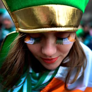 A spectator shows off her green, white and gold eyelashes as the annual Saint Patrick's day parade takes place on March 17, 2018 in Dublin, Ireland. (Photo by Charles McQuillan/Getty Images)
