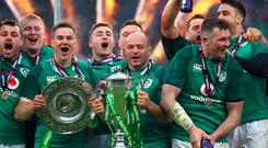Ireland's Rory Best celebrates with the trophy.