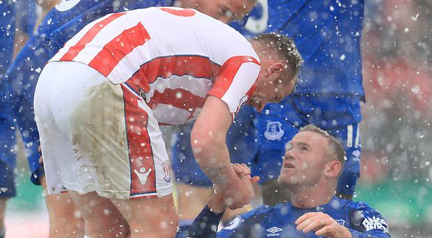 Charlie Adam, right, speaks to Wayne Rooney after being sent off (Mike Egerton/PA)