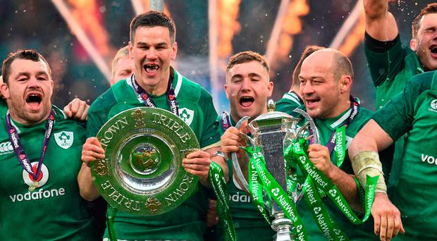 Party time: Johnny Sexton and Rory Best lead the Irish celebrations at Twickenham