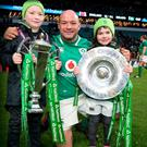 Family matters: Rory Best poses with his children, Ben and Penny, the Six Nations' Trophy and Triple Crown, after Ireland beat England to record only their third Grand Slam in history