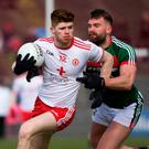 Man marked: Tyrone's Cathal McShane holds off Aidan O'Shea yesterday