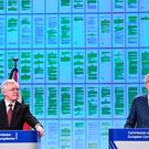 British Brexit minister David Davis (L) and EU chief negotiator Michel Barnier address a press conference after their meeting at the European Commission in Brussels on March 19, 2018.