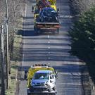 The remains of two cars being taken away from a crash scene on the Collin Road, outside Ballyclare, County Antrim / Credit: Justin Kernoghan - Alan Lewis/ PhotopressBelfast.co.uk