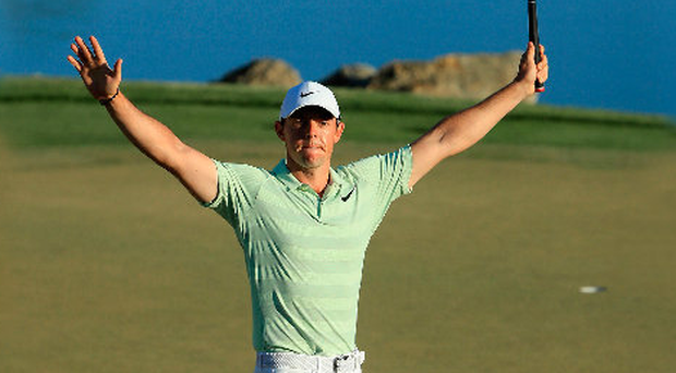 On top: Rory McIlroy hails his birdie on the 18th of the Arnold Palmer Invitational