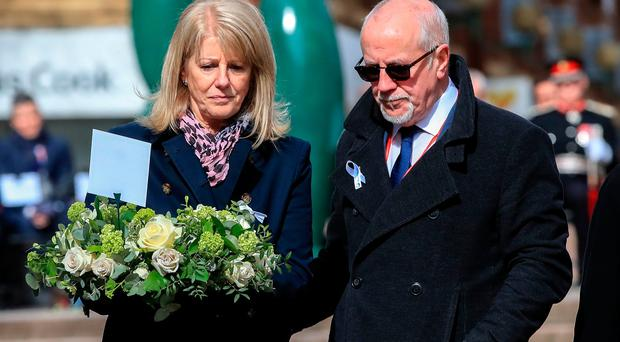 Wendy Parry and her husband Colin (right) lay flowers at the memorial stone on Bridge Street, in Warrington, where two IRA bombs were detonated, killing their son Tim Parry, 12, and Johnathan Ball, three, and injuring over fifty others, during the 25th anniversary service of the Warrington bombing attack. Photo credit Peter Byrne/PA Wire
