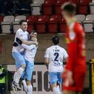 Ballymena United scorer Johnny McMurray (centre) celebrates his 10th goal of the season with Cathair Friel (left) and Tony Kane.