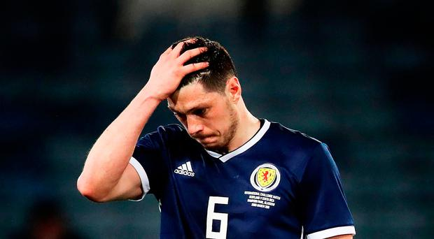 Bad start: Scott McKenna shows his frustration