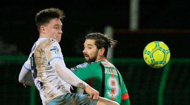 Looking up: Ballymena United matchwinner Kofi Balmer clashes with Glentoran's Curtis Allen