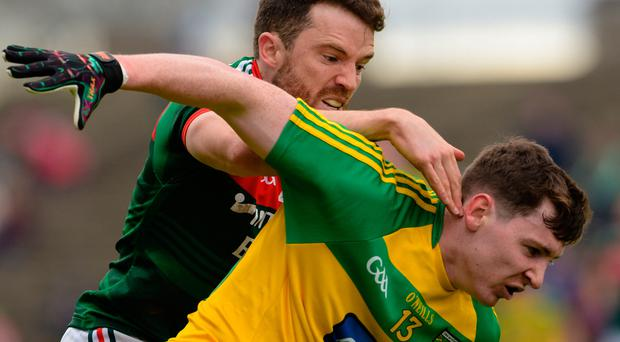 Battle stations: Donegal's Jamie Brennan (right) can expect another rough and tumble clash against Mayo