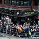 Crowds wait for Prince Harry and Meghan Markle to exit the Crown Bar. Pic: Brian Lawless/PA Wire