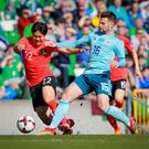 Northern Ireland's Oliver Norwood and Korea Republic's Changhoon Kwon in action during the game at Windsor Park on March 24th 2018(Photo by Kevin Scott / Belfast Telegraph)