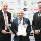Pictured after clinching the top GO award are Gary Young, estates project and energy manager at SRC, Ruairi Lavery, projects director, SRC and Peter Johnston from award sponsor Wilsons Auctions.