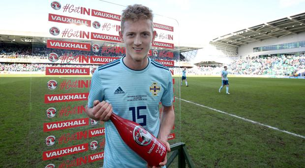 Northern Ireland's George Saville collects his man of the match award