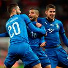 All square: Lorenzo Insigne celebrates scoring Italy's equaliser from the penalty spot after Jamie Vardy had shot England into a first-half lead