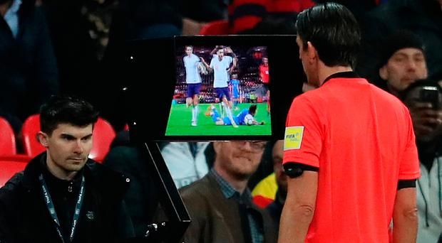 Dubious call: Referee Deniz Aytekin uses the VAR system