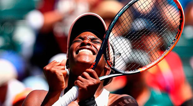 All smiles: Sloane Stephens after defeating Angelique Kerber